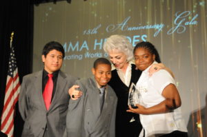 From left: Fremont High School students Cristian Salazar and Derjuan Jacocks, Chair of Friends of UMMA - Mrs. Hoori Sadler, and Fremont student Shaquera Johns.